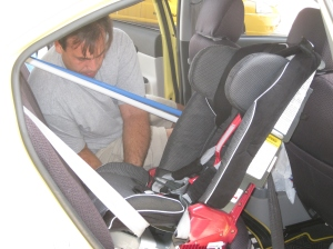 The infamous baby car seat and Gio installing it.
