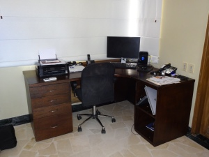 Gio's custom-made desk. A good fit... for the space and our budget!