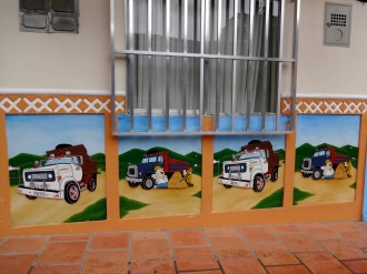 Not all zócalos tell of times gone by. Marcello was a fan of these pictures that decorate a trucking or construction business.