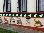 Some zócalos tell you about the person or business inside. These are on a home for the elderly.