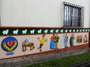 The zócalos on the side of this hospital show the cycle of life from conception to death and the afterlife.
