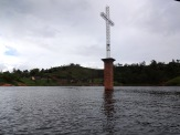This cross marks the town of Viejo Peñol, which was flooded in 1978 to create the Peñol-Guatapé Reservoir that produces approximately 30% of Colombia's energy. The town, originally founded in 1714, was relocated to a new spot nearby.