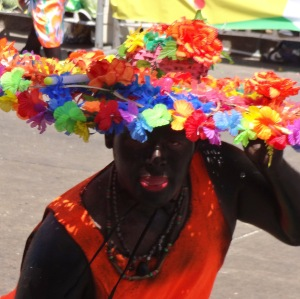 The black face paint and bright red lip paint are used for the Son de Negro costume.
