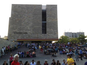 People gather outside the Museo del Caribe, in the Parque Cultural, for a free music event.