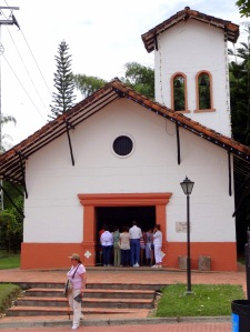 Standing Room Only for Sunday Mass at the Parque del Café theme park's church in its small town replica.