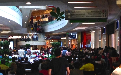 People crowding in for Sunday Mass at Santafe Mall in Medellín